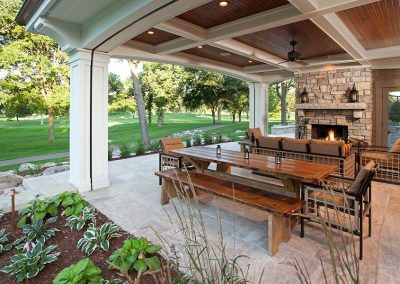 covered outdoor kitchen in Interlachen Country Club home in Edina