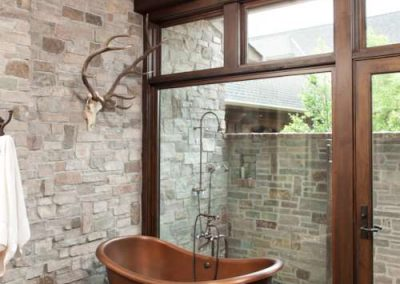 bath in Rustic Medina renovation by John Kraemer and Sons