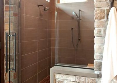 shower renovation in Rustic Medina project by John Kraemer and Sons