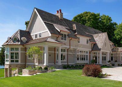 angled front view of John Kraemer & Sons Lake Minnetonka Coastal style home