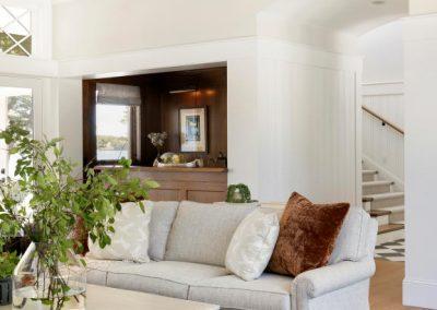 great room in John Kraemer & Sons Lake Minnetonka Coastal style home