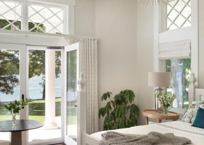 master bedroom in John Kraemer & Sons Lake Minnetonka Coastal style home