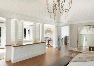 bedroom walkout in John Kraemer & Sons Lake Minnetonka Coastal style home