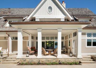 patio in John Kraemer & Sons Lake Minnetonka Coastal style home