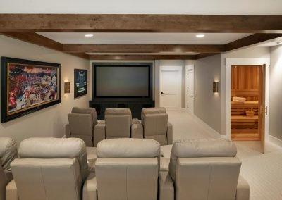 home theater and sauna in John Kraemer & Sons Lake Minnetonka Coastal style home