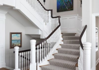 John Kraemer & Sons Lake Minnetonka Chateau in-suite grand stairway