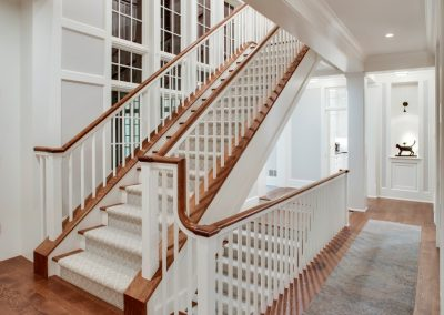 grand staircase at Carman Bay Cottage