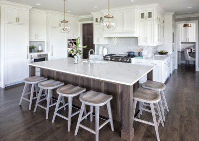 kitchen island in Orono Deer Hill Preserve by John Kraemer & Sons