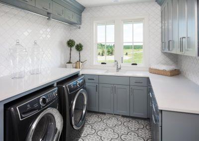 laundry room in Orono Deer Hill Preserve by John Kraemer & Sons