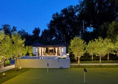 putting green beside Rolling Green Pool Cabana